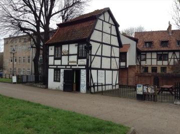 Tudor-style building, 2 storey, narrow, white with beams