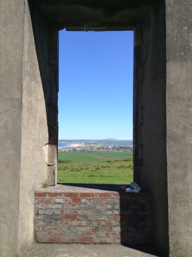 Downhill view through a window from the Demesne
