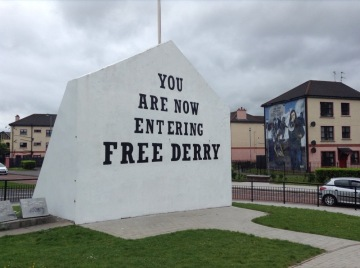 "Monolith with text: ""You are now entering Free Derry"""