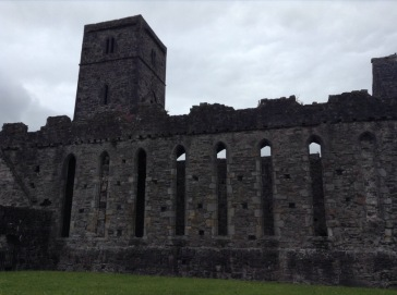 Ruined abbey wall, high tall thin windows