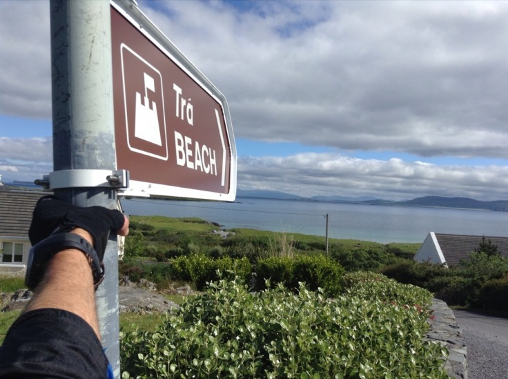 Sign pointing to the beach