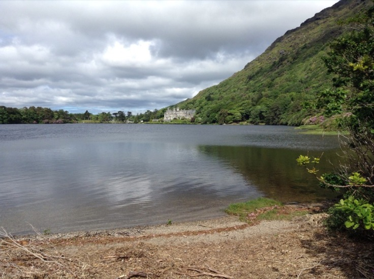 Scrub beach over a lake, looking over Kylemore Abbey