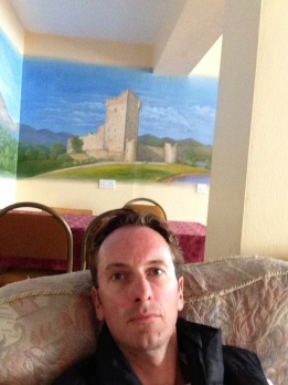 Me, in front of a painting of a castle
