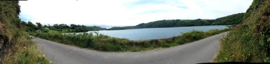 Panorama of road next to a lake