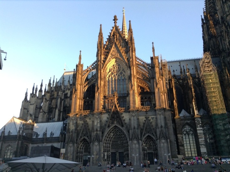 Gothic cathedral, upper half still lit by the sun