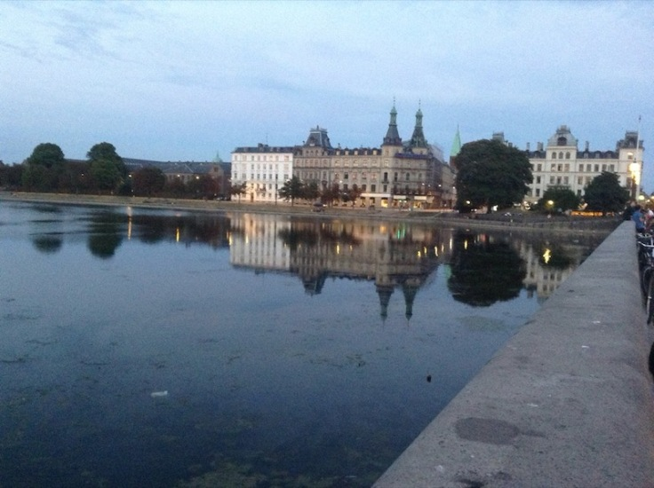 Castle-like building reflected in a man-made lake, Copenhagen