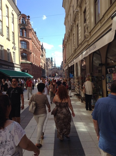 A busy pedestrian area with shops on either side, Stockholm