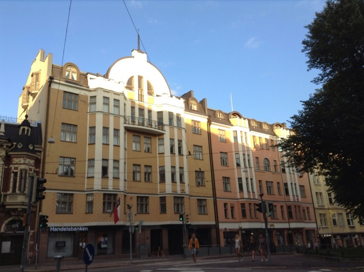 Yellow and apricot coloured buildings under a blue sky in Helsinki