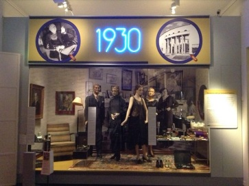 Display case headlined 1930, with dressed mannequin to show fashion of the time