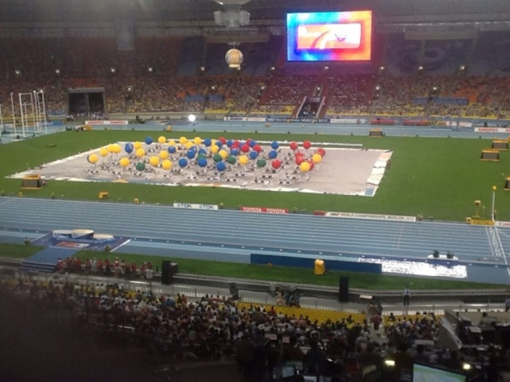 Opening ceremony. People holding up oversize balls and jumping