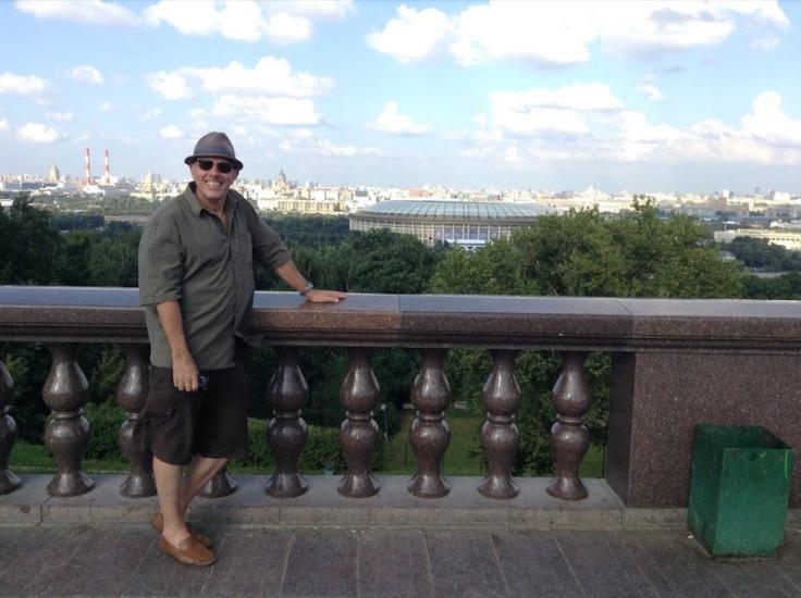 Steve Ovett leaning on a railing overlooking Luzhniki Stadium in the distance