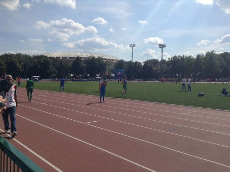 Italy's relay team warm up on the practice oval
