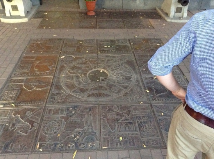 Carved floor covering, each square a different country. France, India, Germany all legible
