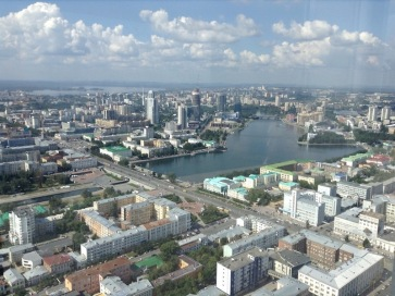 View of Yekaterinburg, white, aqua and green rooves plus the city pond