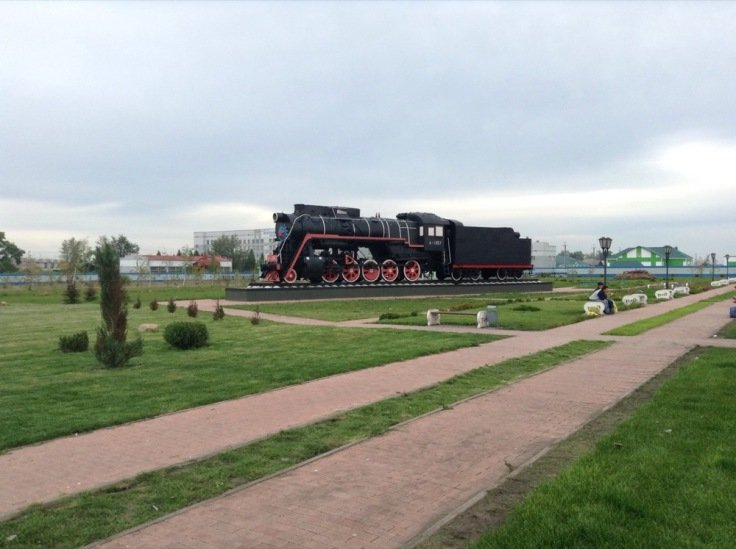 Old steam train mounted as an exhibit in a park