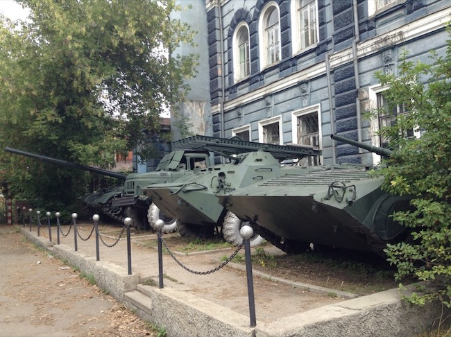 Military vehicles parked outside a building