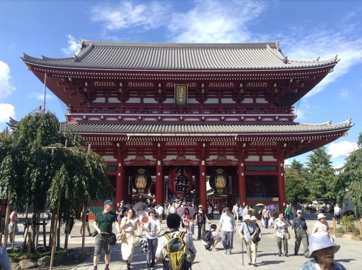 Kaminarimon, a two level pagoda, tall and imposing, red with white detailing