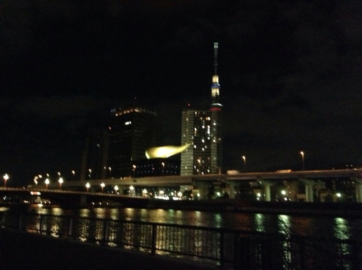 View of Tokyo, and the building with the huge horn sticking out of the side, by night