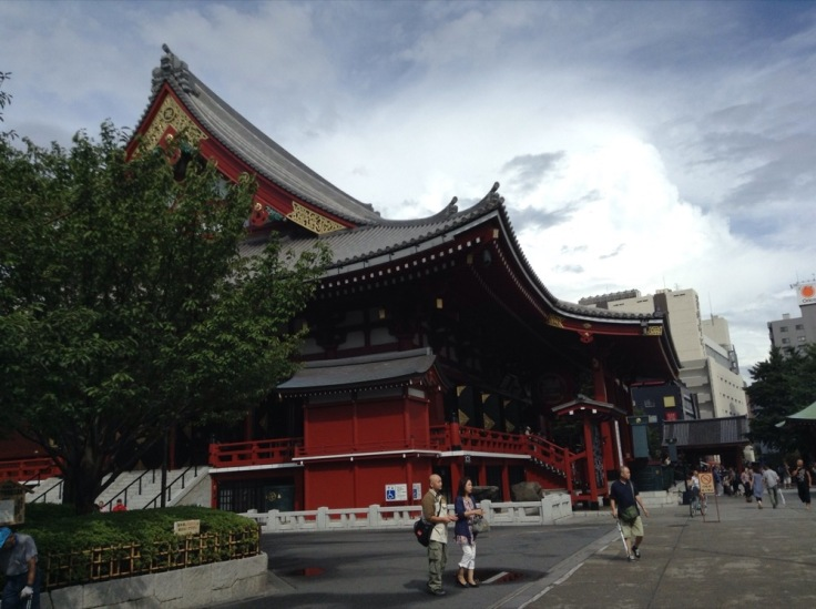 Large red temple with huge sloping roof