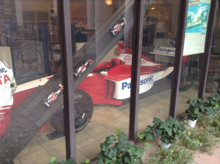 F1 Toyota car behind glass
