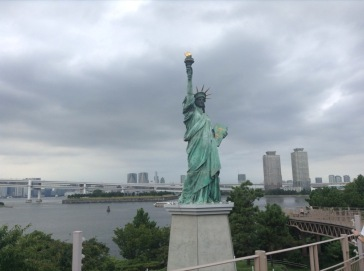 Statue of Liberty in Tokyo, skyscrapers and water behind