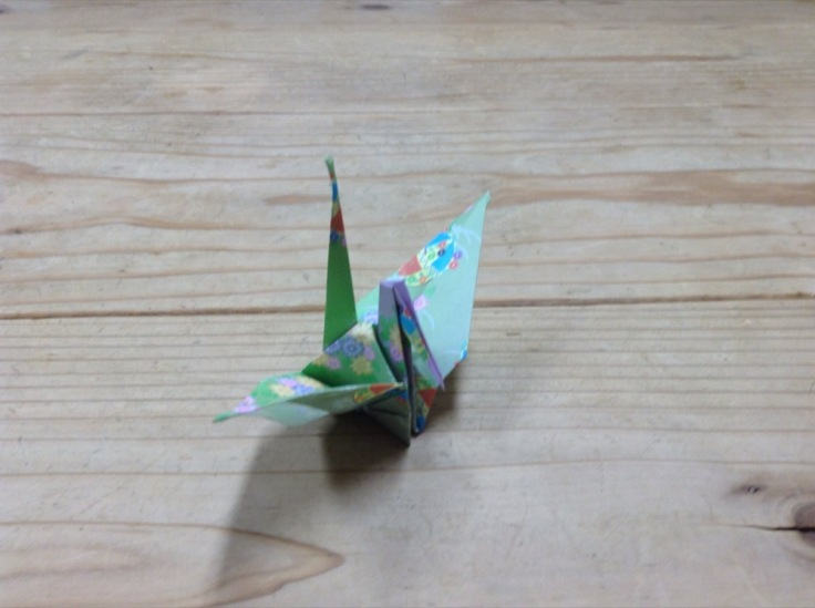 A crane made from flower-decorated paper