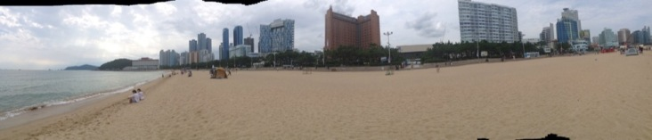 Beach panorama; bit of sea to the left, lots of high buildings off to the right