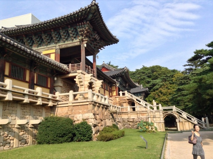 Old Korean building, rock and sloping roofs