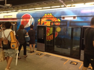 Metro train, with Pepsi and Manchester United logos