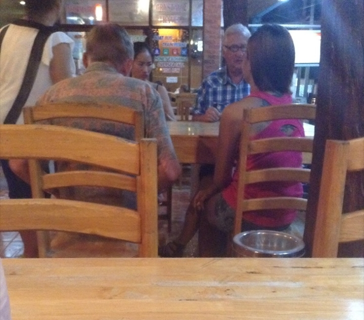 Two old blokes, with two young Thai girls