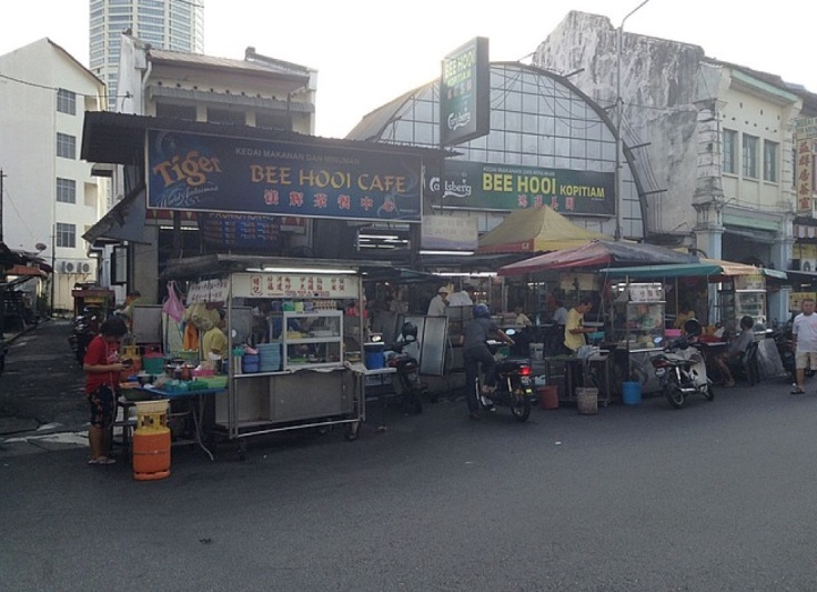 Bee Hooi Cafe and Bee Hooi Kopitiam, advertising Tiger and Carlsberg beer, respectively