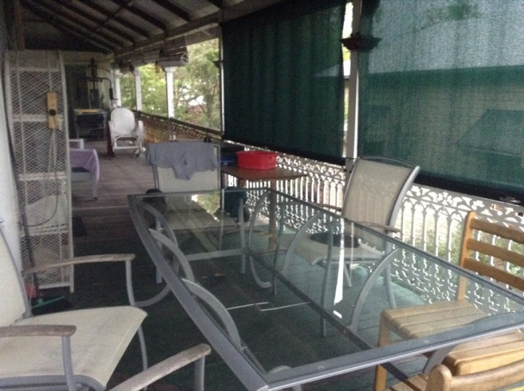 Glass-topped table and chairs on the huge, wide verandah