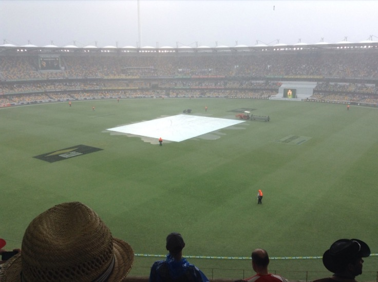 Covers on at The Gabba, as rain falls