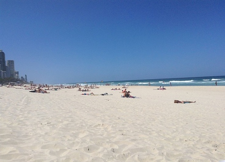 Wide beach at Surfers. White sand, blue sea.