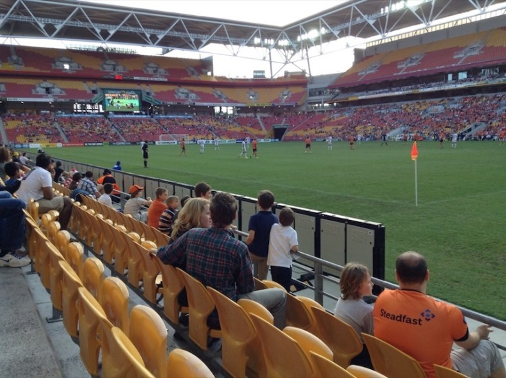 Watching Perth Glory, as spectators sing.