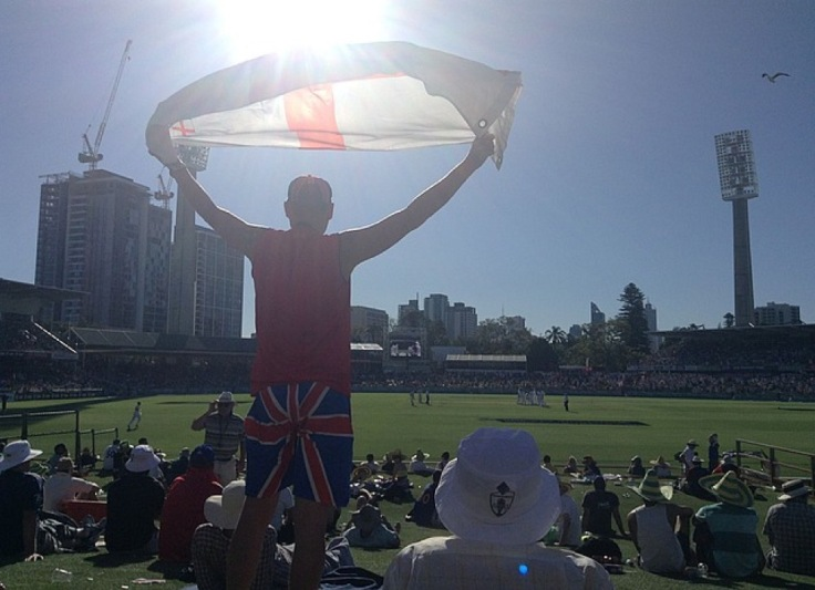 Man standing, waving an England/Wales flag, as England do well (for a while)