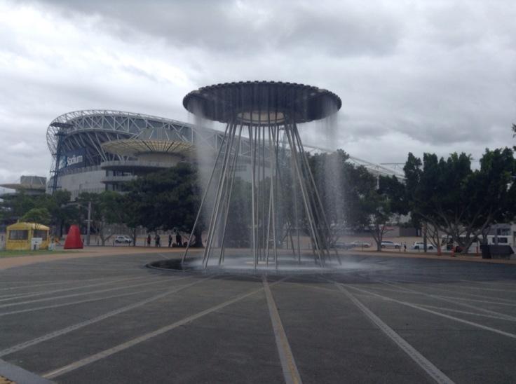 Cauldron - a circular fountain in a public square, near the stadium