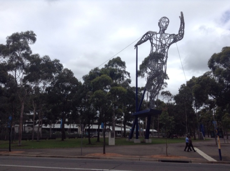 Huge, mesh sculpture of a sprinter, held in place by wires