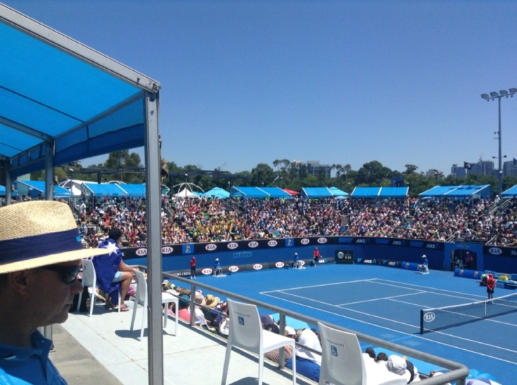 Seats filled now matches have started; sun overhead makes it hot