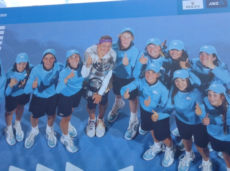 Group of ball boys and girls and a champion. One ball girl the spitting image of Jessica Ennis.