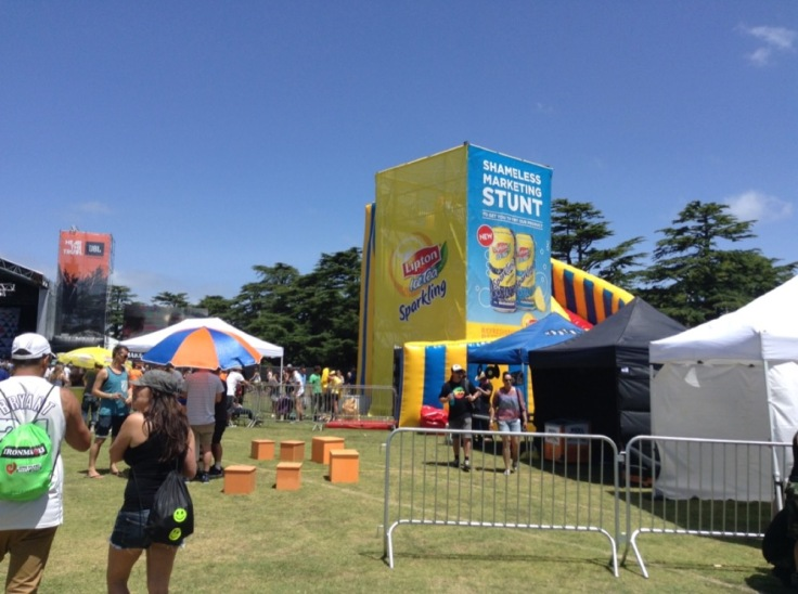 Tall advertising for Lipton Ice Tea, with giveaways underneath