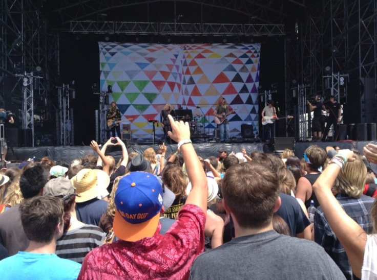 Grouplove on the stage, crowd enjoying them in sunshine