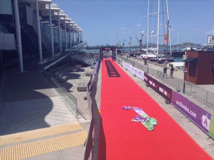 Red carpet and advertising hoardings mark the finish for the Ironman