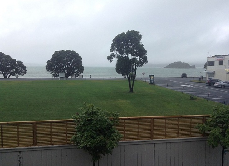 View of lawn then sea, from the hostel