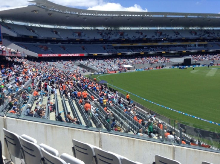 Eden Park looks empty, but the fans are making noise in the sun