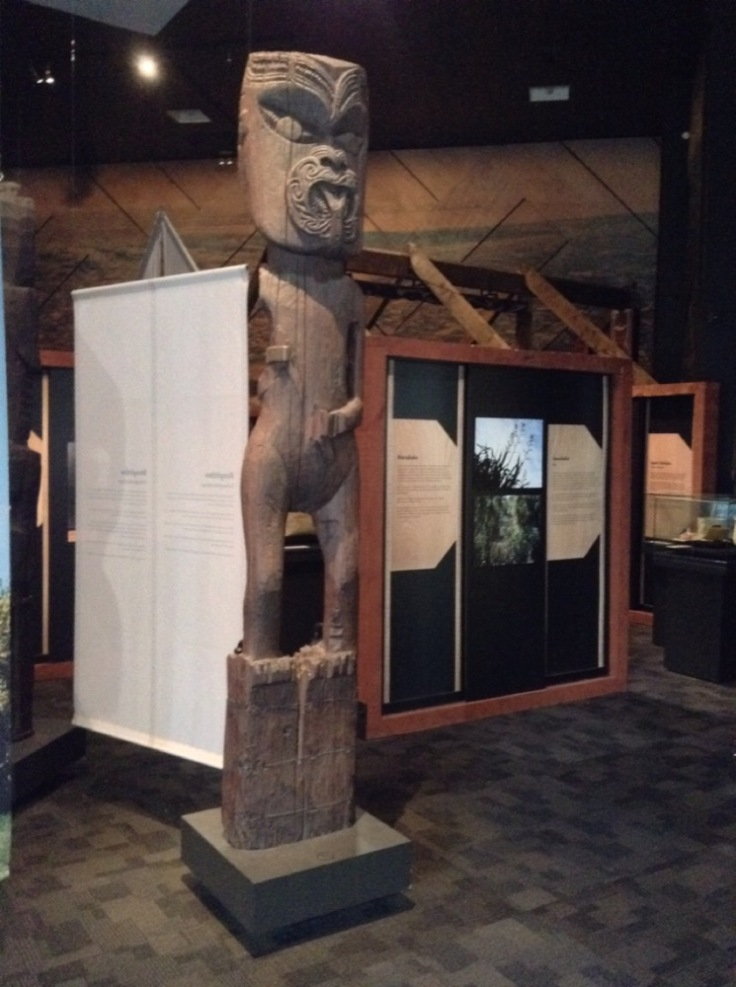 Tall statue, made of wood, in the museum