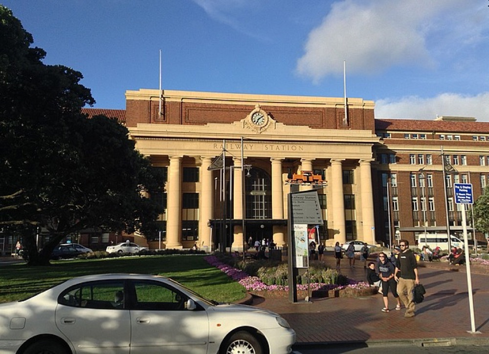 Yellowy stone and brick, with gothic columns at Wellington Railway station.
