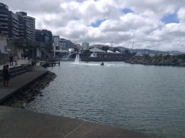 Person using a jet pack above the water, Wellington