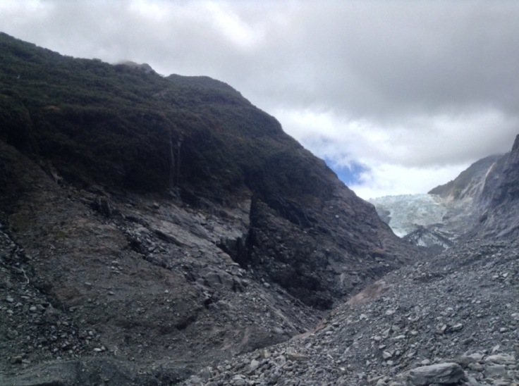 Rocky landscape, glacier retreated to the far end and looks small