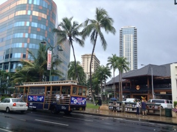 Hard Rock Cafe in Honolulu, with a trolley car (on wheels) going past